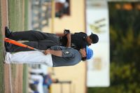Wilson Post 13 head coach Matt Ballance, right, talks with umpire Leo Lockhart during a March 21 game against Kenly Post 358 at Fleming Stadium. Wilson takes the No. 3 seed into the Area I East playoffs, which begin Tuesday at Pitt County Post 39.