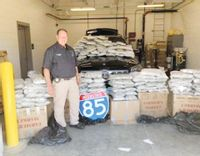 Granville County Sheriff Charles Noblin poses with around 158 pounds of marijuana he said deputies seized during a traffic stop near Stem on June 17. Contributed photo