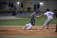 Blaize Keen, left, of Wilson Post 13 evades the tag of Kinston Post 43 pitcher Justin Strickland on his way to score in the fifth inning of Wednesday's Area I East playoff game at Fleming Stadium. Wilson lost 10-5 to end its season.
