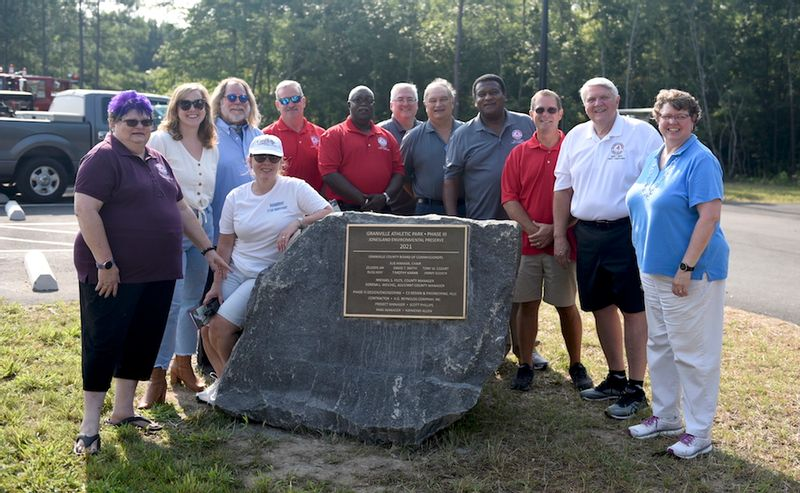 The Phase 3 expansion to Granville Athletic Park was dedicated on Saturday. From left, County Commissioner chair Sue Hinman; Korena Weichel, assistant county manager; Charla Duncan, former county analyst; Michael McFadden, member of the Parks and Recreation Committee; Commissioners Russ May and Zelodis Jay; County Manager Mike Felts' Commissioners Jimmy Gooch, Tony Cozart, Tim Karan and David Smith; and Charlynne Smith, director of Recreation Resources Service.