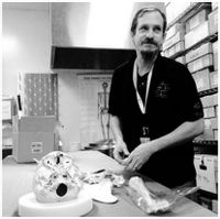 Medical Examiner Specialist Clyde Gibbs in the bone room at the Office of the Chief Medical Examiner in Raleigh in 2014.