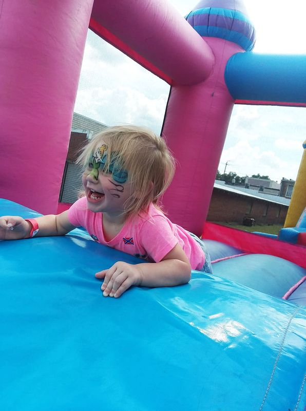 The annual Four Oaks Acorn Festival features a Kids Zone with inflatables.