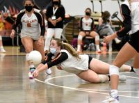 Morgan Newton dives from the back row to make the dig for the Lady Firebirds in Wednesday's match against Louisburg.