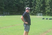 CCS eight-player football coach Andy Jackson oversees the start of practice Wednesday afternoon. Jackson will lead the Cyclones into a season where CCS will compete as an independent with no postseason access after departing the NCISAA. Jimmy Lewis | Times