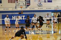 Hunt's Kayla Haley (12) watches as South Central's Jadyn Smith (1) is unable to dig up this kill during Monday's match at Hunt. The Lady Warriors won in three sets. Flanking Haley at the net for South Central are Kaci Turnage (4) and Mirian Hardy (10).