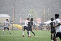 Falls Lake Academy and Granville Central battled through a downpour Friday. Falls Lake won 2-0.