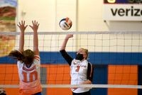 Anna Holcombe, right, powers the ball over Louisburg's Taylor Leonard at the Aug. 25.