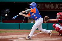Taylor, Mich.'s Jackson Surma (22) hits a double off Hamilton, Ohio's Chance Retherford, driving in two runs, during the first inning of the Little League World Series Championship game in South Williamsport, Pa., on Sunday.