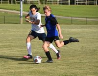 Hunt's Jay Misback (6) tries to get by the defense of Rocky Mount's Griffin Perry (17) during the first half of Monday's game at Hunt. The Warriors and Gryphons battled to a 2-2 draw. Jimmy Lewis | Times