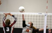 Morgan Newton goes up and taps the ball over the net for Falls Lake Academy in the 3-0 win over Franklinton on Aug. 27.