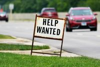 A help wanted sign is displayed at a gas station in Mount Prospect, Ill., on July 27.