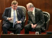 House Speaker Tim Moore, left, talks with Senate President Pro Tempore Phil Berger on April 26. Republicans in the North Carolina legislature finally agreed on how much they want to spend on state government next year, loosening a fiscal knot that delayed House and Senate budget work for weeks.