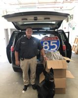 Granville County Sheriff Charles R. Noblin poses with more than 100 pounds of marijuana his office said it seized during a traffic stop last month.