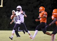 Luke Sharon, left, tells his receiver to keep running as the Orange High defense closes in for a sack.