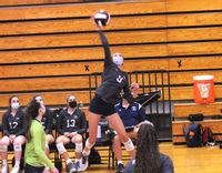 Heritage's Kate Dawson throws down a hard spike at Wakefield.