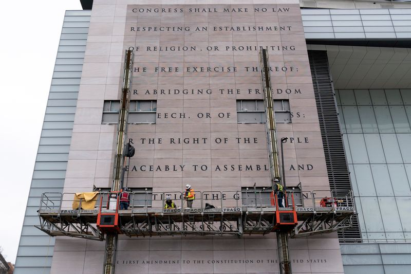 Workers remove the facade inscribed with the First Amendment of the U.S. Constitution from the building that formerly housed the Newseum, a private Washington museum dedicated to exploring modern history as told through journalists' eyes, on Feb. 12. The facade was later reinstalled at the National Constitution Center in Philadelphia.