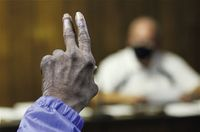 Bob James, a second vice president of the NAACP's Wilson Branch, raises his hand to ask a question of Lucama Mayor Jeff Johnson during Monday's Lucama Board of Commissioners meeting.