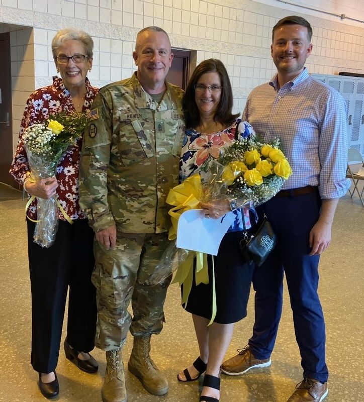 Nash County sheriff's Capt. Robert Bowen, standing with his family, received a N.C. National Guard promotion Saturday from sergeant major to command sergeant major of the 1-252 Armor Regiment.