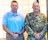 Nash County Sheriff Keith Stone stands with Capt. Robert Bowen, who was promoted to command sergeant major of the N.C. National Guard's 1-252 Armor Regiment on Saturday.