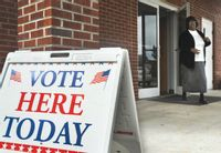 A voter exits Middlesex Baptist Church after voting on Nov. 5, 2013.