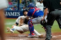 Toronto Blue Jays catcher Alejandro Kirk (30) tags out Tampa Bay Rays' Kevin Kiermaier trying to score during the sixth inning of Monday's game in St. Petersburg, Fla.