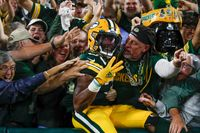 Green Bay Packers' Aaron Jones celebrates his touchdown run during the second half of Monday's against the Detroit Lions in Green Bay, Wis.