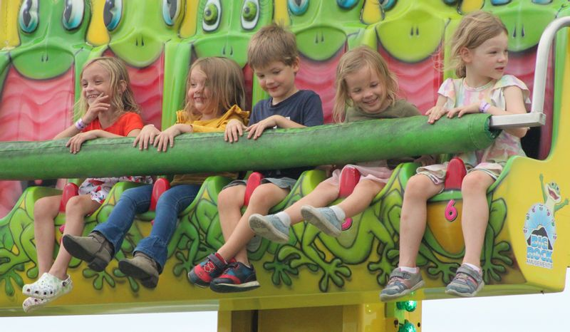 Riders on the Frogger enjoy the experience Tuesday at the Wilson County Fair.