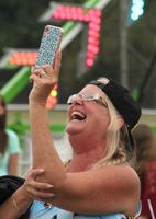 Trish Pritchett of Lucama takes family members' picture at the Wilson County Fair on Tuesday.
