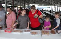 Attendees browse the Wilson County Fair's annual baked goods sale on Tuesday.