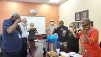 Sallie B. Howard School of Arts & Science teachers and administrators toast their 2021 National Blue Ribbon School Award with sparkling cider.