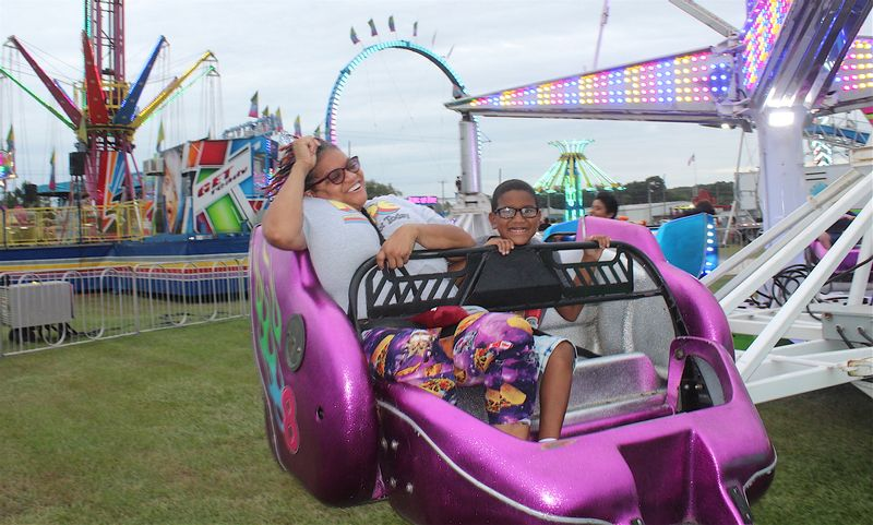 Andrea and Bruce Caldwell enjoy the Sizzler ride Tuesday at the Wilson County Fair.