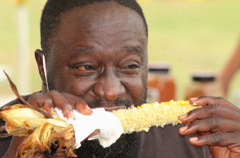 Tony Gaines of Wilson devours an ear of corn Tuesday at the Wilson County Fair.