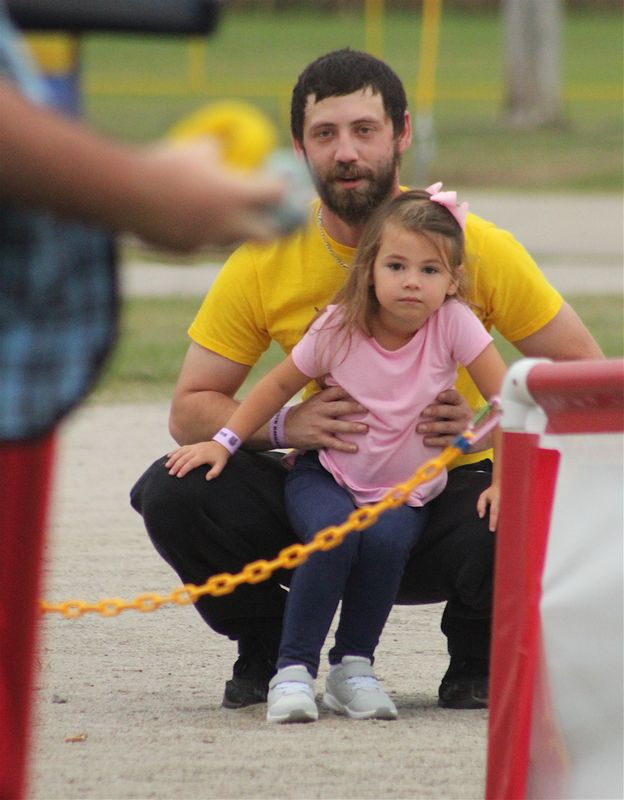 Allen Pugh and daughter Madalyn Pugh watch Tuesday's Lew-E clown show at the Wilson County Fair.