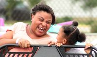 Nancy Dickerson and daughter Ava ride the Sizzler at the Wilson County Fair on Tuesday.