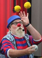 Lew-E the Clown juggles at the Wilson County Fair on Tuesday.