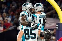 Carolina Panthers quarterback Sam Darnold (14) celebrates his touchdown run with Dan Arnold (85) and Cameron Erving (75) during the first half of Thursday's game in Houston.