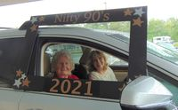 Bertha Marcinowski and guest Norma Feller take their picture during the Nifty Nineties event.