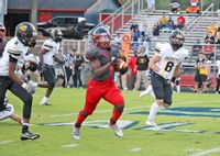 Southern Nash's Sammy Gandy (6) runs with the ball during the first half of Friday's game against Roanoke Rapids. Gandy ran for 184 yards and two touchdowns as the Firebirds improved to 4-0 overall and 2-0 in the 2-A/3-A Big East Conference with a 56-14 victory.
