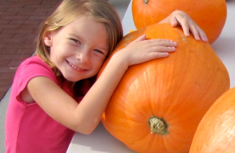 A little girl hugs her pumpkin during a recent Spring Hope National Pumpkin Festival. After the COVID-19 pandemic canceled the event last year, the 49th annual festival is scheduled this weekend. For more details, see the October issue of Wide Awake inside this week's edition of The Enterprise.
