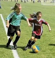Players from the Excite and Bulldogs battle for the ball during a recent Wilson Parks and Recreation girls ages 7-8 soccer match at Gillette Soccer Complex.