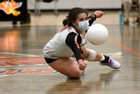 Halie Carroll dives to keep the ball in play for Falls Lake Academy during the Monday night match against Granville Central.