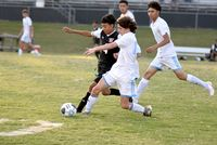 Lewis Gonyea, right, gains control of the ball during the Sept. 29 match against Webb.