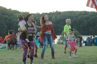 Line dancers show their moves during live music Friday at Lake Holt's Labor Day fireworks show.