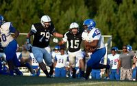 The Granville Central defense tries to stop the Person running back in the back field.